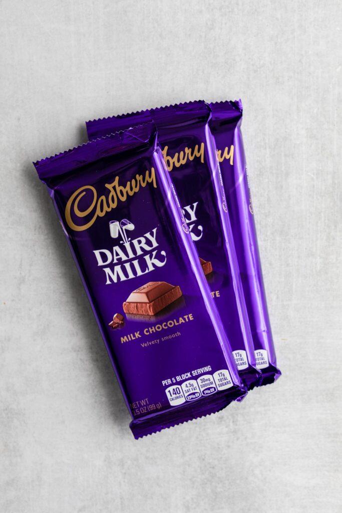 cadbury chocolate bars on a grey surface