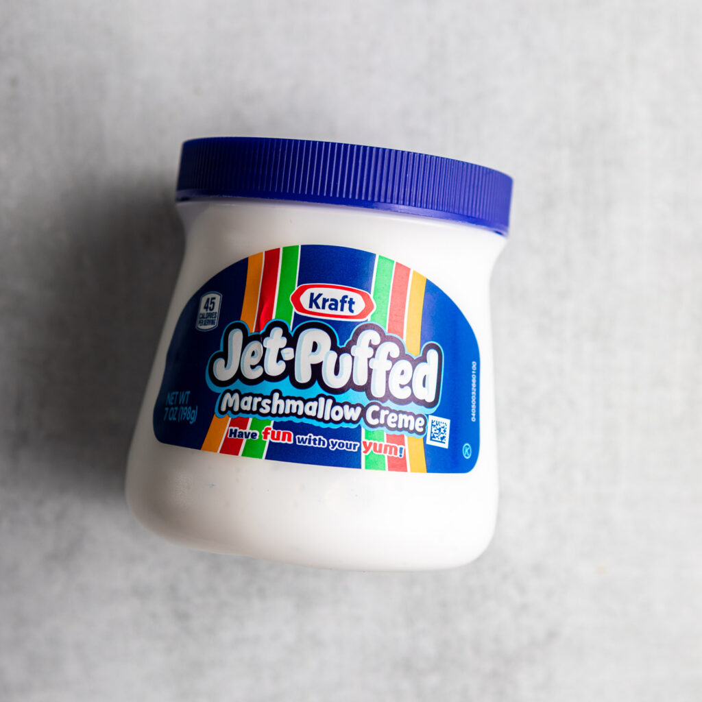 container of jet puffed marshmallow creme on a grey surface