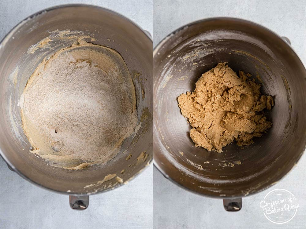 dry ingredients added to creamed butter and sugar in a metal mixing bowl on a grey surface