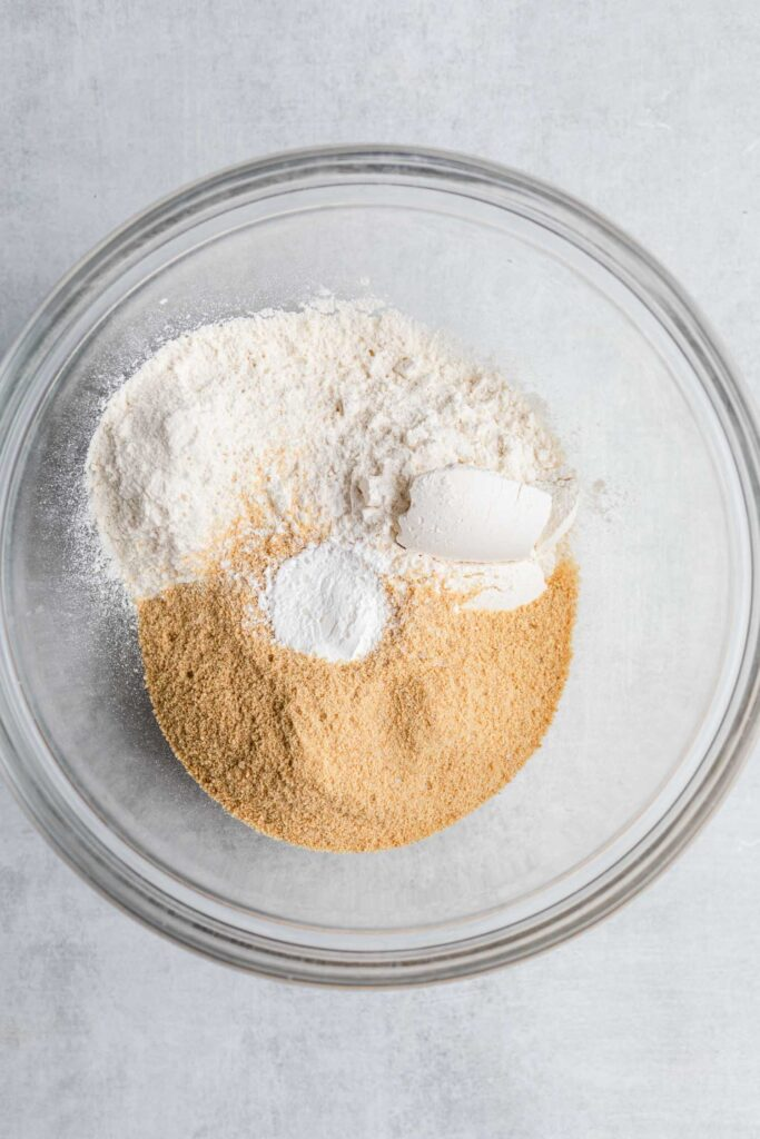 graham cracker crumbs, flour, salt, and baking soda in a glass bowl
