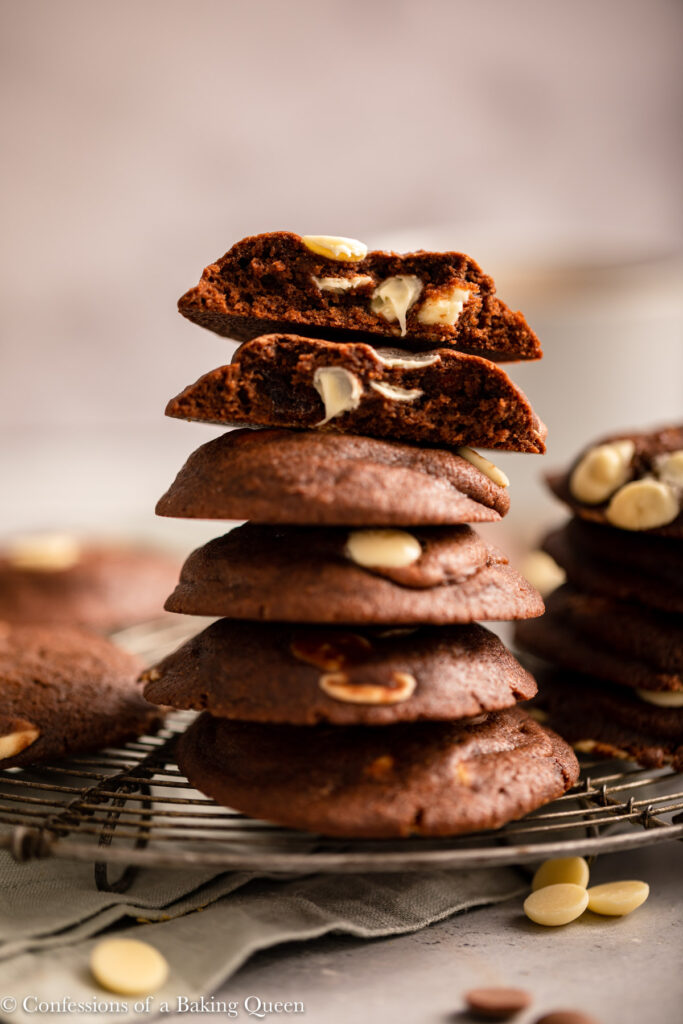 stack of baileys chocolate cookies on a wire rack on a light grey surface
