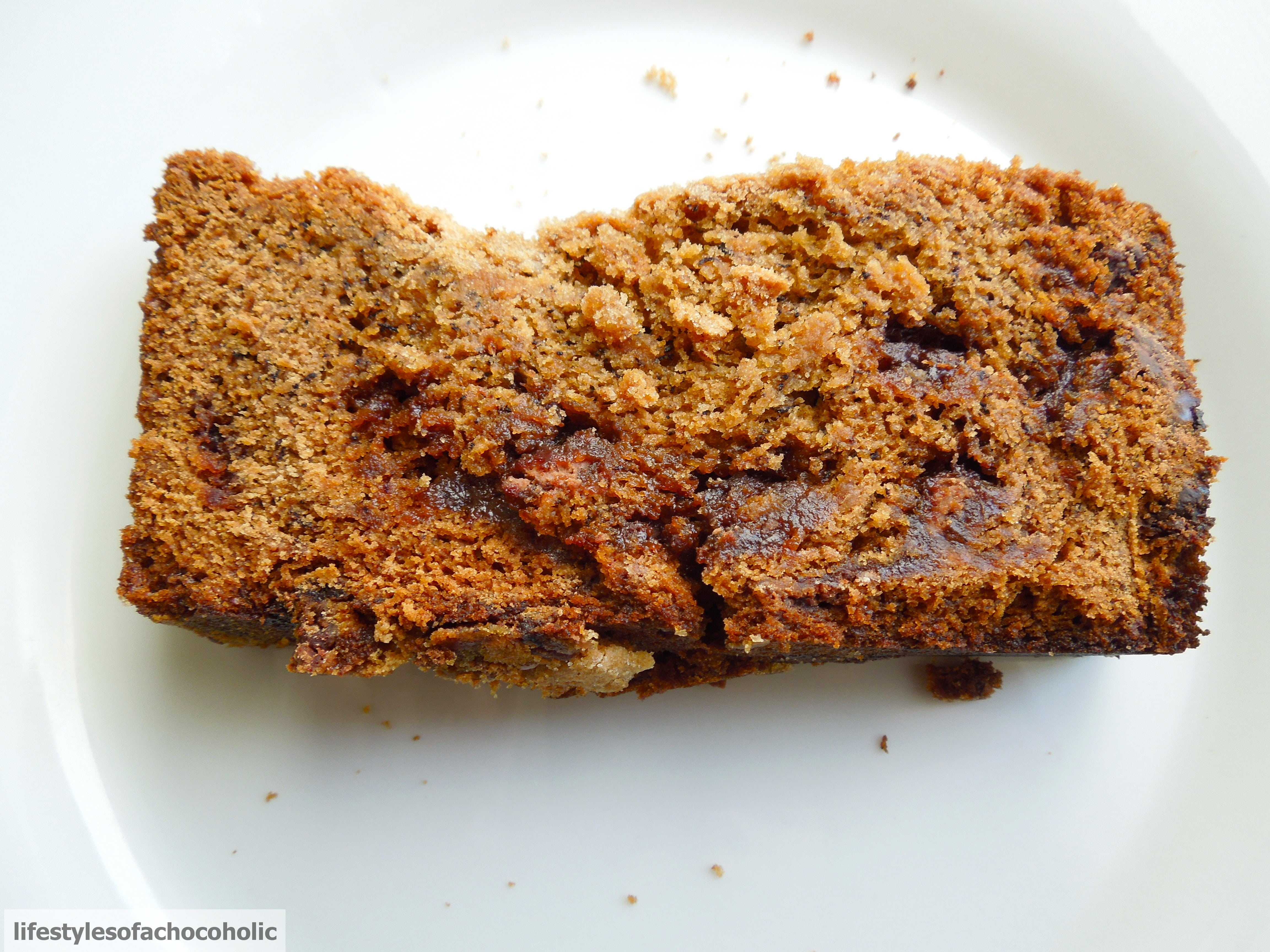 Biscoff Chocolate Chip Banana Bread slice on a white plate