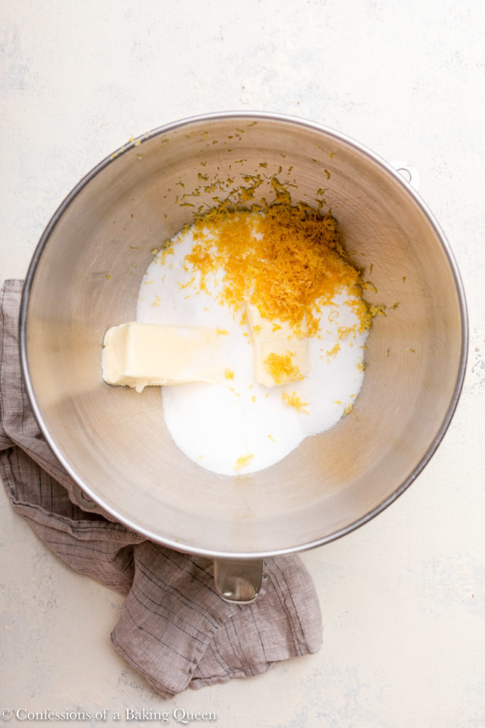 butter, sugar and lemon zest in a metal mixing bowl