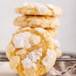 lemon crinkle cookie against a stack of cookies