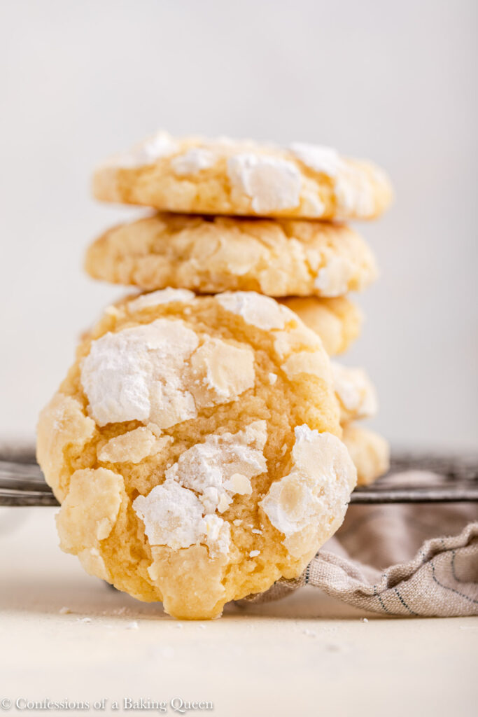 lemon crinkle cookie against a stack of cookies