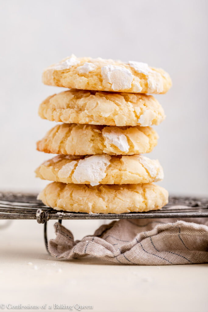 stack of lemon crinkle cookies on a metal rack