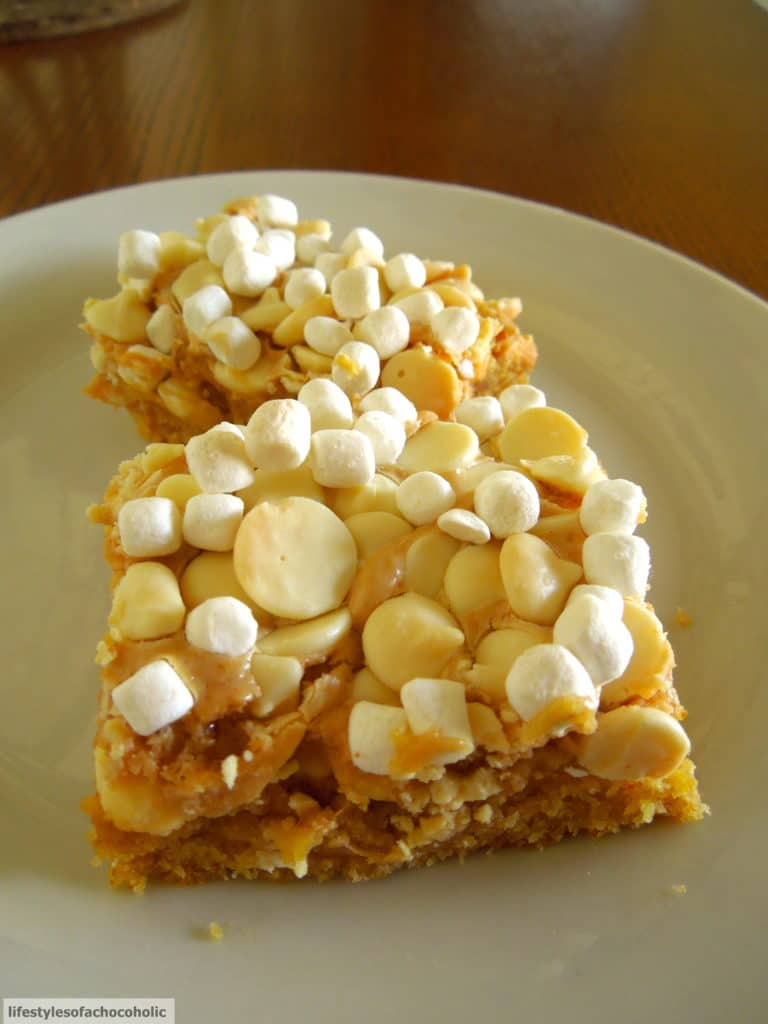 Peanut Butter Marshmallow White Chocolate Bars on white plate on a wood surface