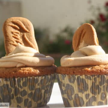 two biscoff cupcakes on a white plate