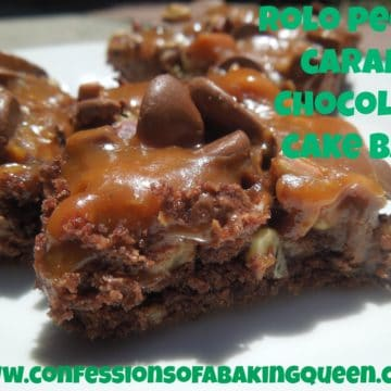 close up of Rolo Pecan Caramel Chocolate Cake Bars on a white plate