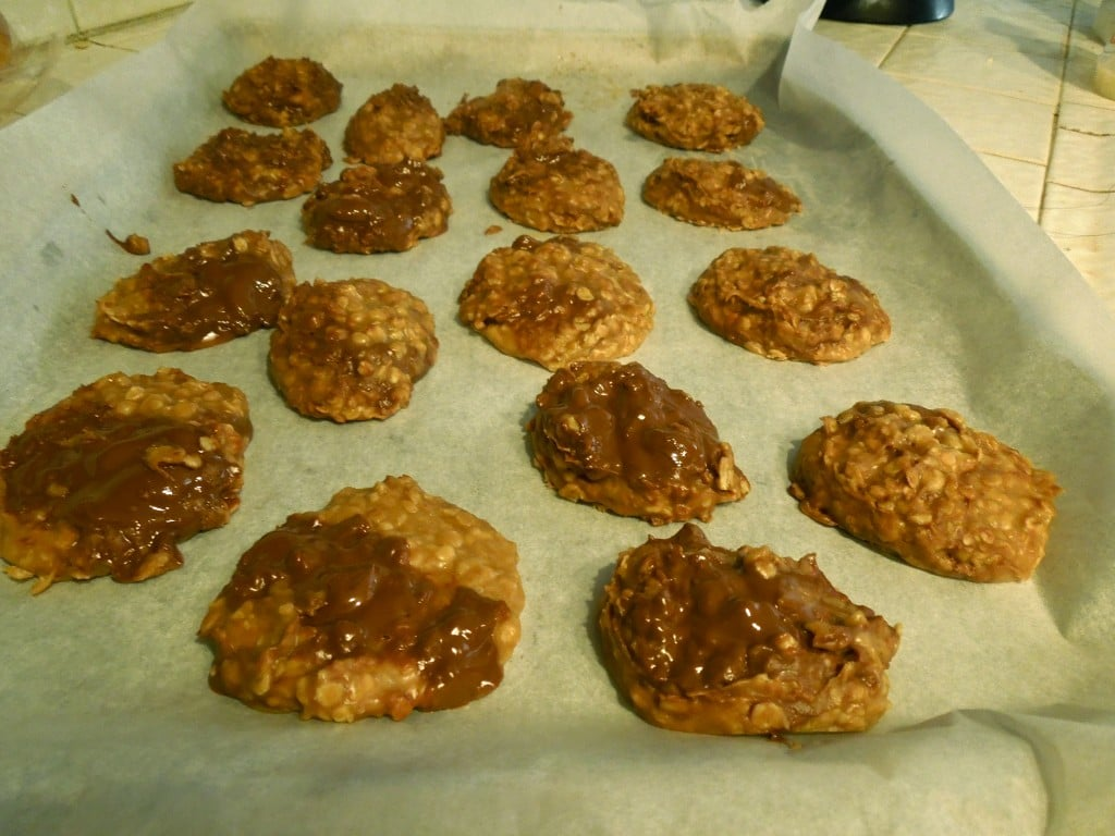 no bake chocolate biscoff cookies on a parchment lined baking sheet to set
