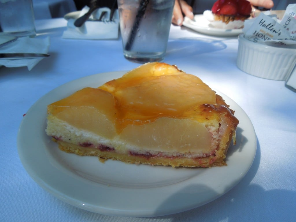 fruit tart on a white plate from Andersen\'s danish bakery in Santa barbara