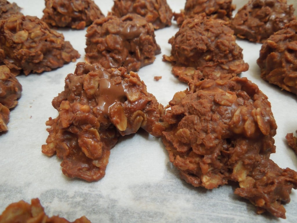 no-bake chocolate oat cookies on parchment-lined baking sheet