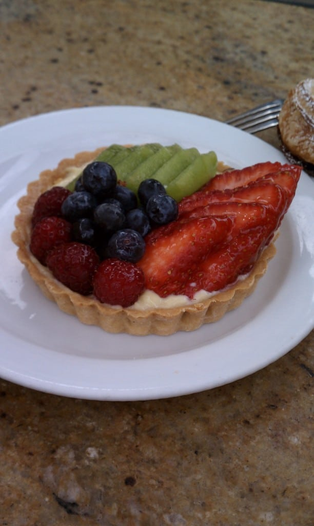 close up of a fruit tart on a white plate