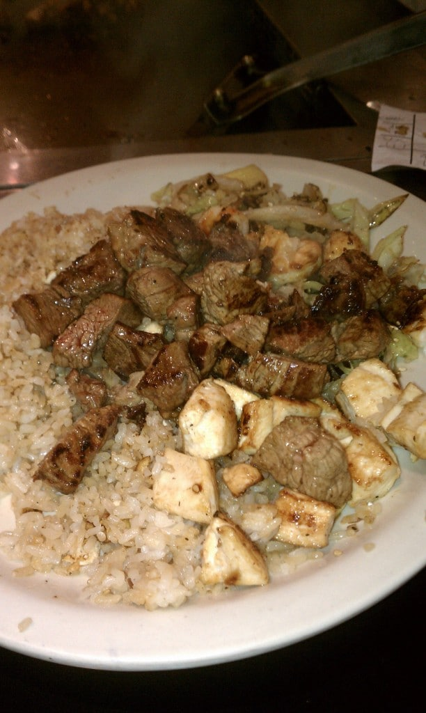 close up of steak and chicken dinner on a white plate from Bari Bari