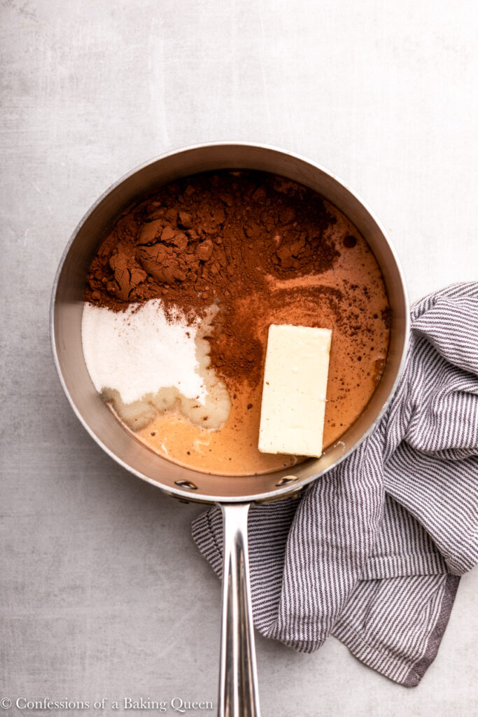butter, sugar, cocoa powder, and milk in a metal pot