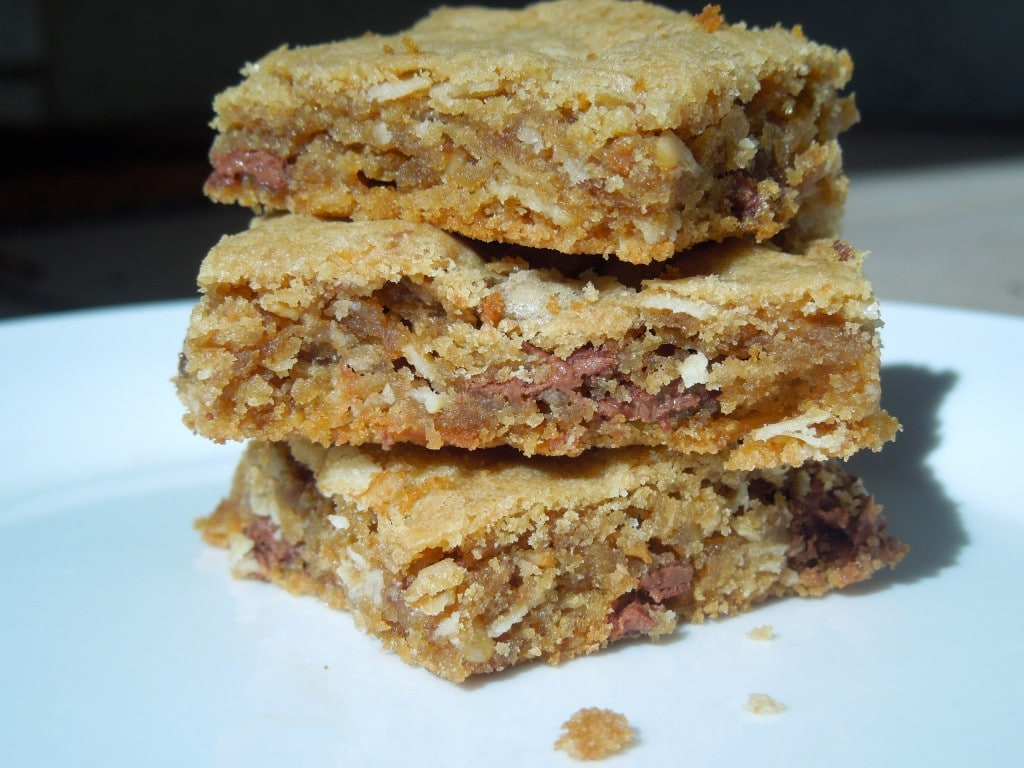 biscoff oat blondies stacked on top of each other on a white plate