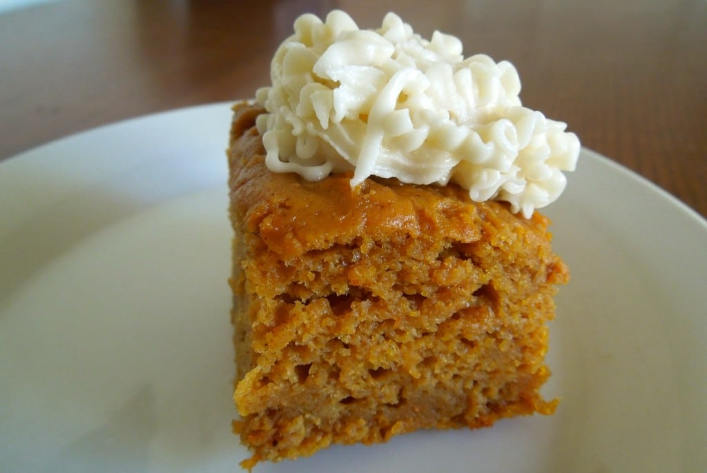 pumpkin bar with cream cheese frosting close up on a white plate