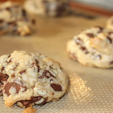 Andes Chocolate Chip Cookies just baked on a silpat lined baking sheet