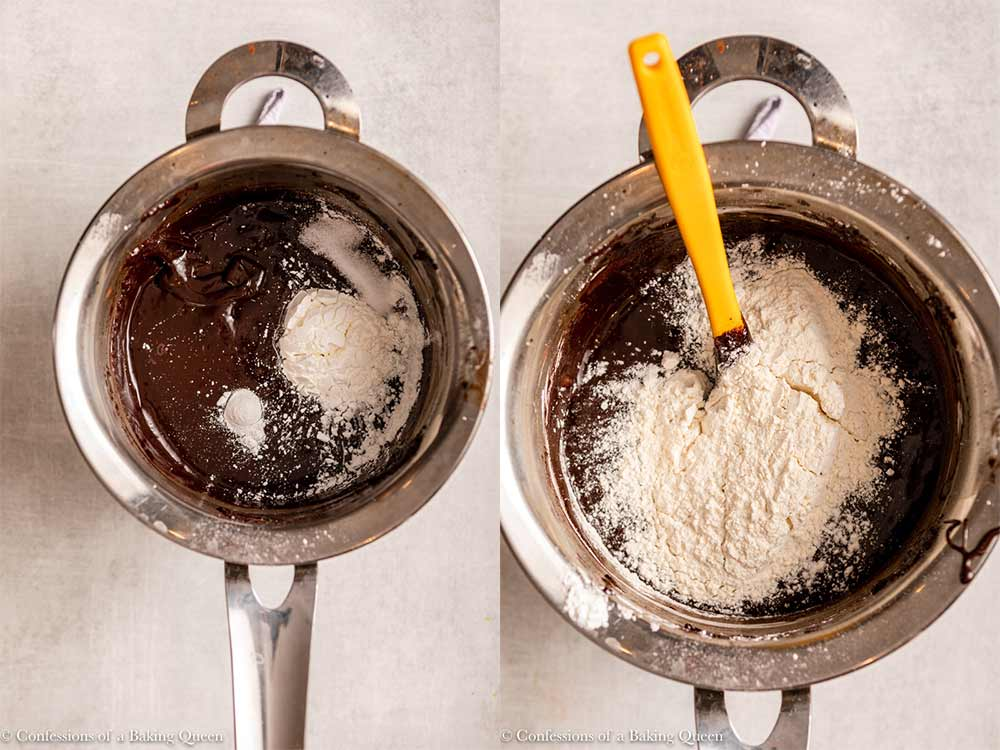 dry ingredients added to brownie batter in a metal pot on a light grey surface