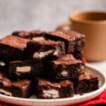 peppermint patty stuffed brownies served on a plate with a red linen