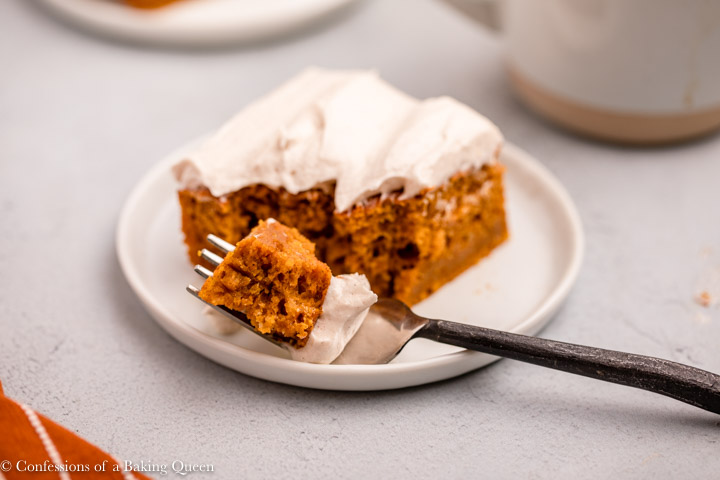 fork taking a bite of a pumpkin bar with cream cheese frosting