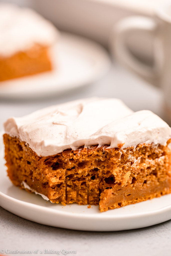 close up of a half eaten pumpkin bar with cream cheese frosting