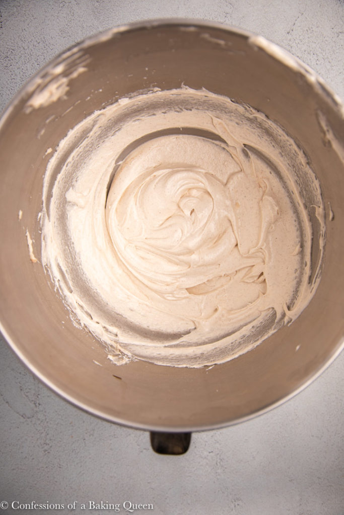 cream cheese frosting in a metal bowl