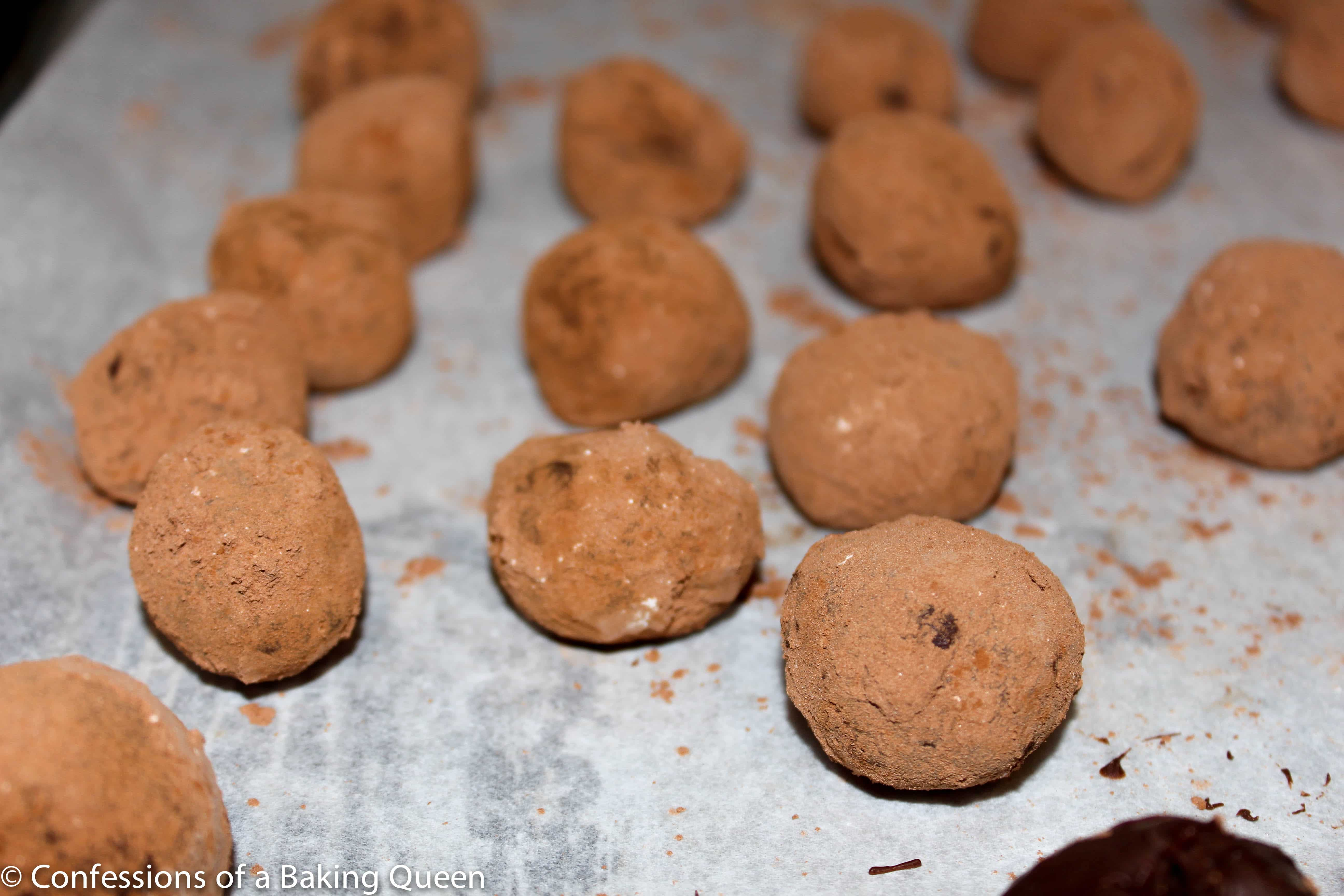 Bailey's Truffles rolled in cocoa powder on a baking sheet