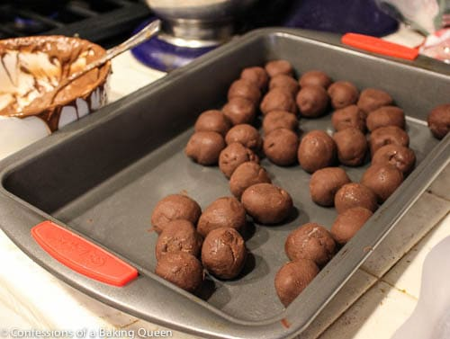 Sea Salt Truffles rolled and sitting in a metal baking pan before dipping