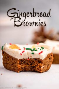 cream cheese frosted gingerbread brownie with a bite taken out