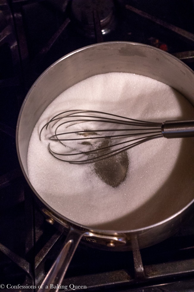 sugar in a heavy bottomed pan with a whisk to start making homemade salted caramel sauce