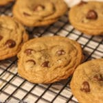 Brown Butter Chocolate Chip Cookies cooling on a wire rack sitting on a white counter top