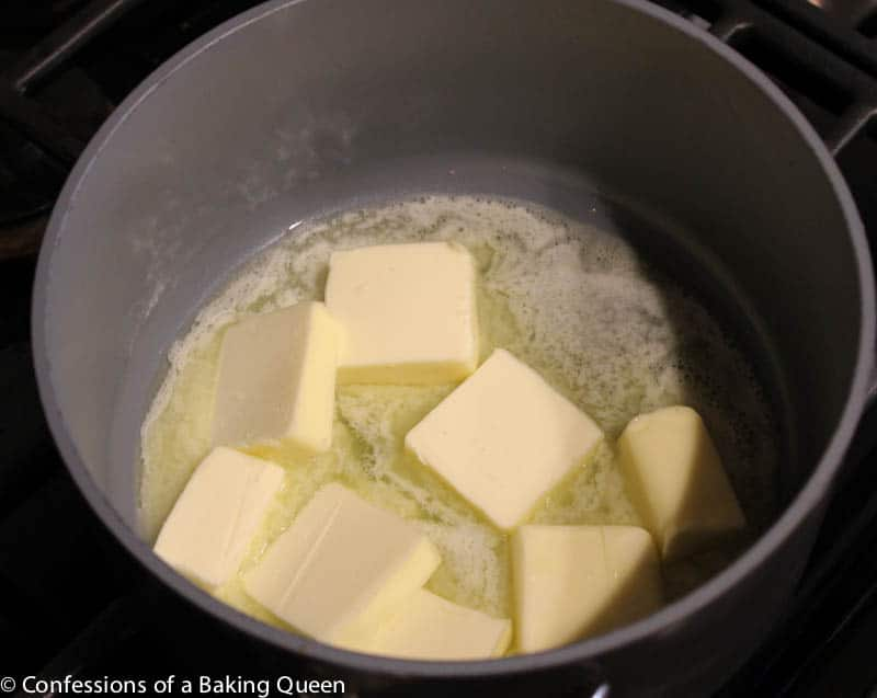 butter being browned for Brown Butter Chocolate Chip Cookies in a silver pot