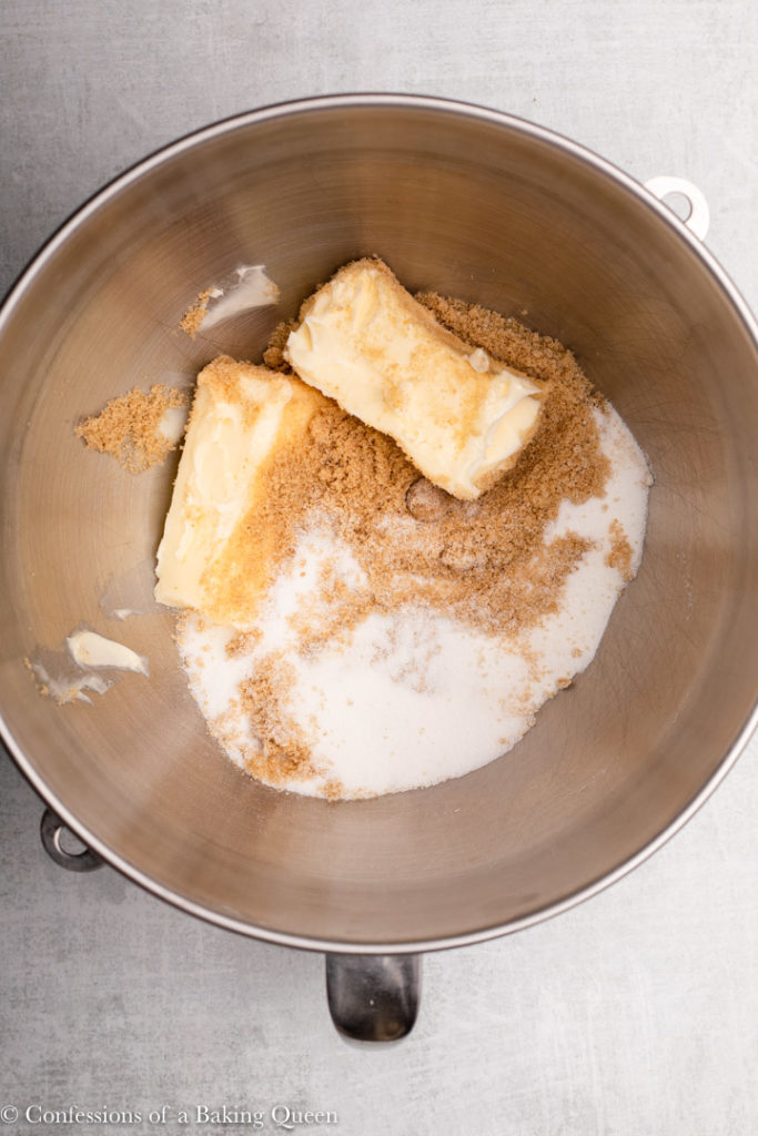 butter, sugar, and brown sugar in a metal mixing bowl