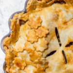clove apple pie baked to golden brown perfection