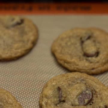 Oat Flour Chocolate Chip Cookies cooling on a silpat liner on a wire rack