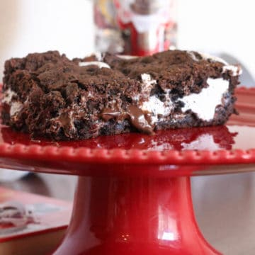 oreo smores bars on a red plate on a wood table