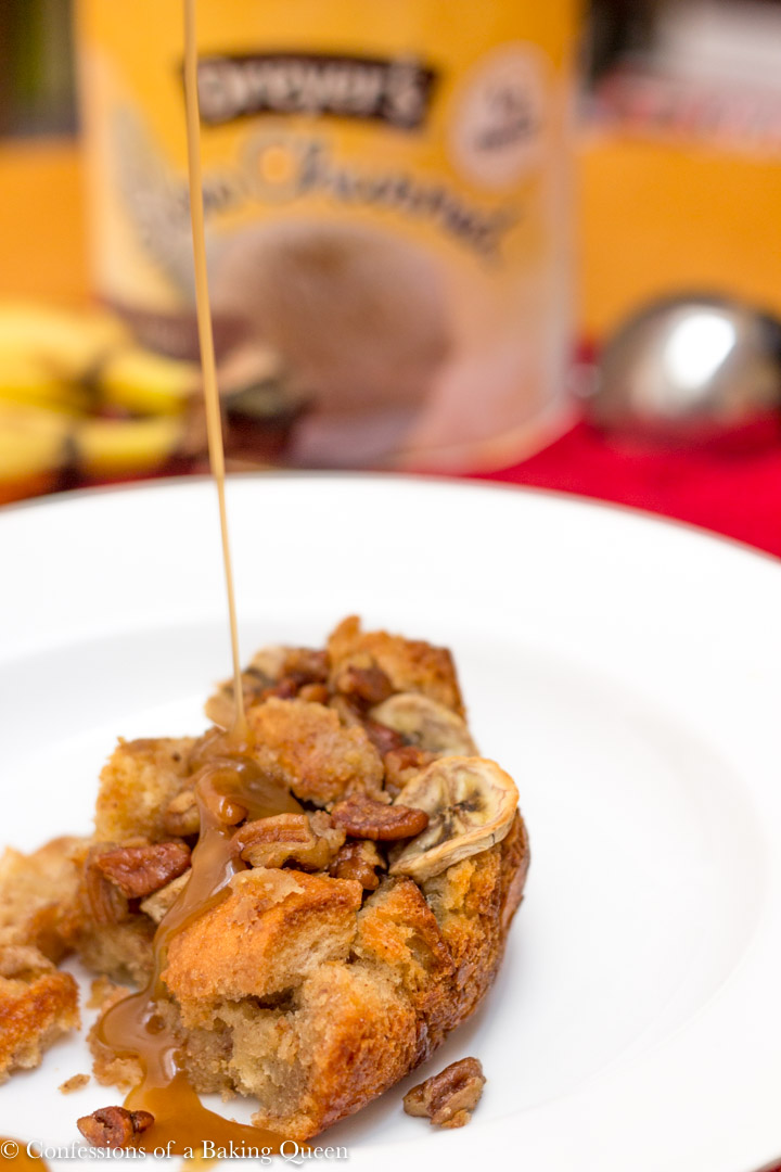 bananas foster bread pudding in a large bowl with caramel dripping on it