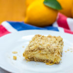 lemon crumb bars on a white plate