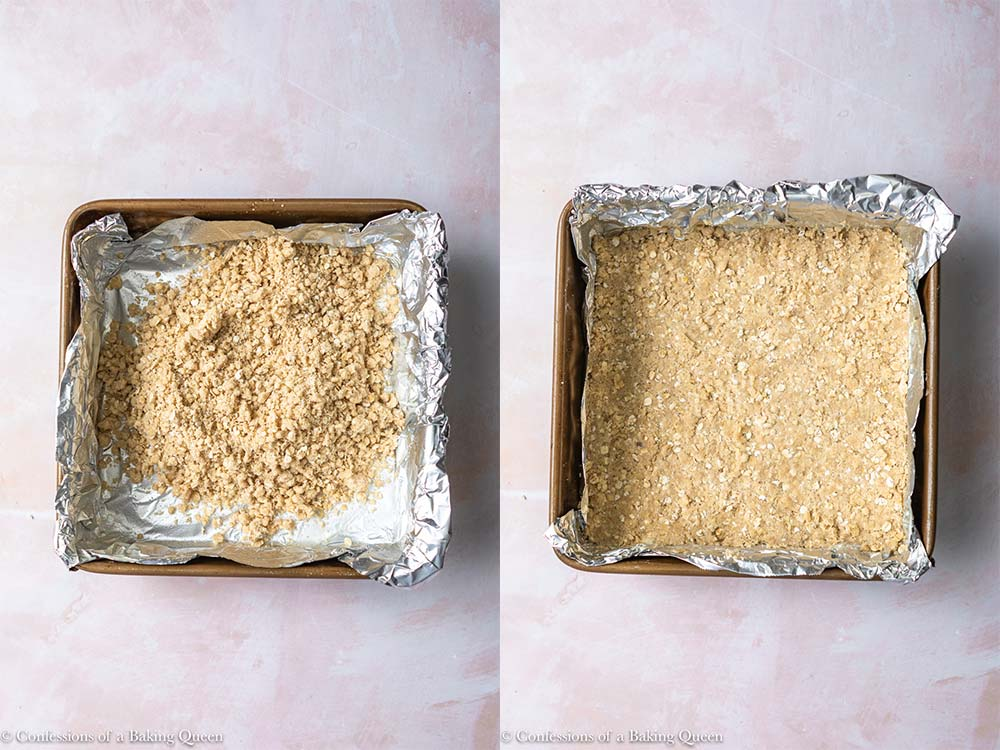 crumb mixture added to a foil lined baking pan and pressed down tightly on top of a pink background