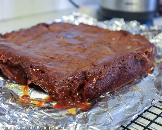 Salted Caramel Heath Bar Stuffed Brownies just baked and cooling on foil