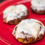 apple cinnamon roll doughnuts on a red plate