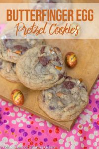 butterfinger egg pretzel cookies on a wood board next to a oink coth