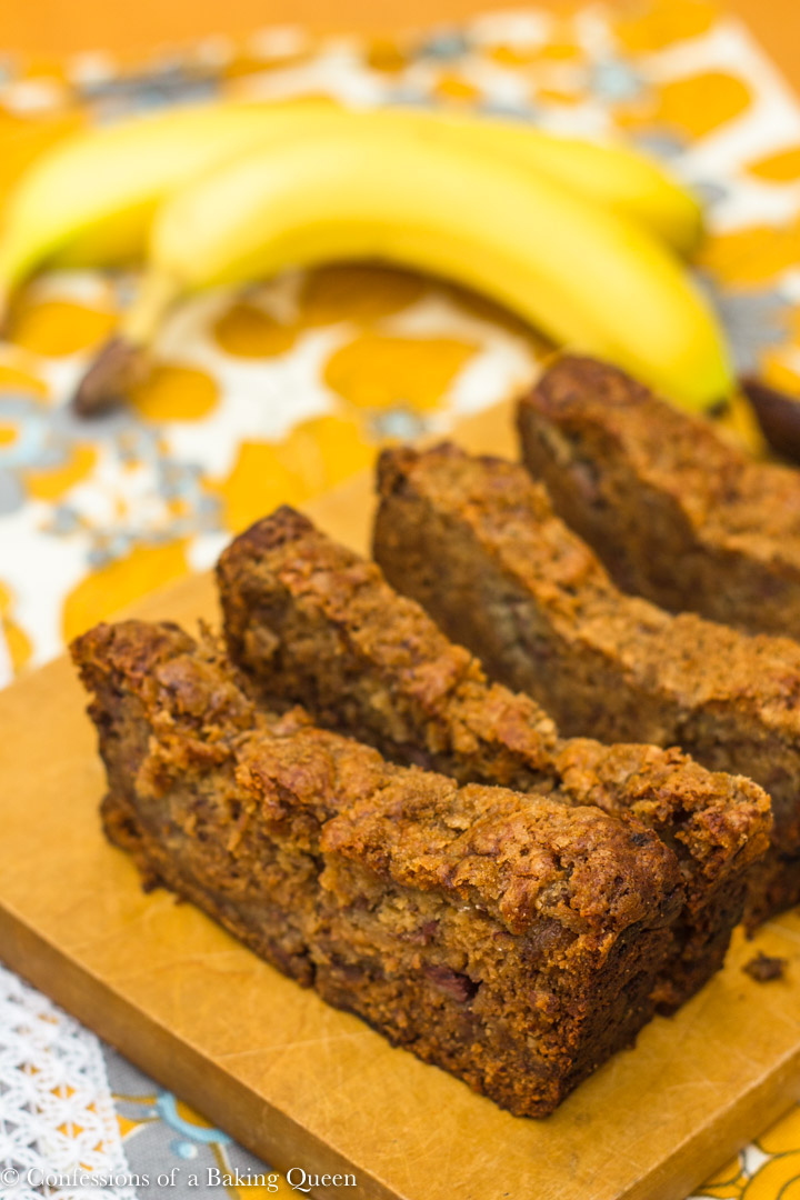 slices of pudding banana bread on wood board