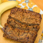 sliced pudding banana bread loaf on a wood board