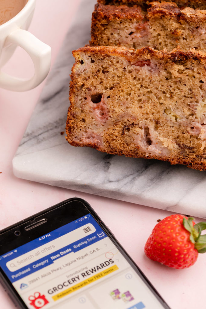 alberstons app on phone next to strawberry banana bread