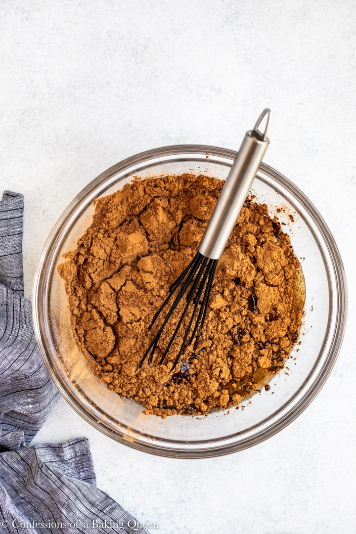 cocoa powder added to guinness mixture in a glass bowl