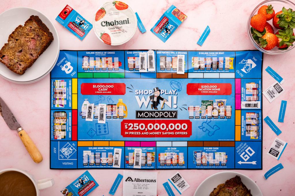 monopoly board next to banana bread