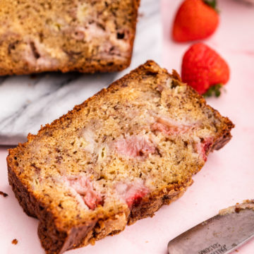 slice of strawberry banana bread falling off the platter