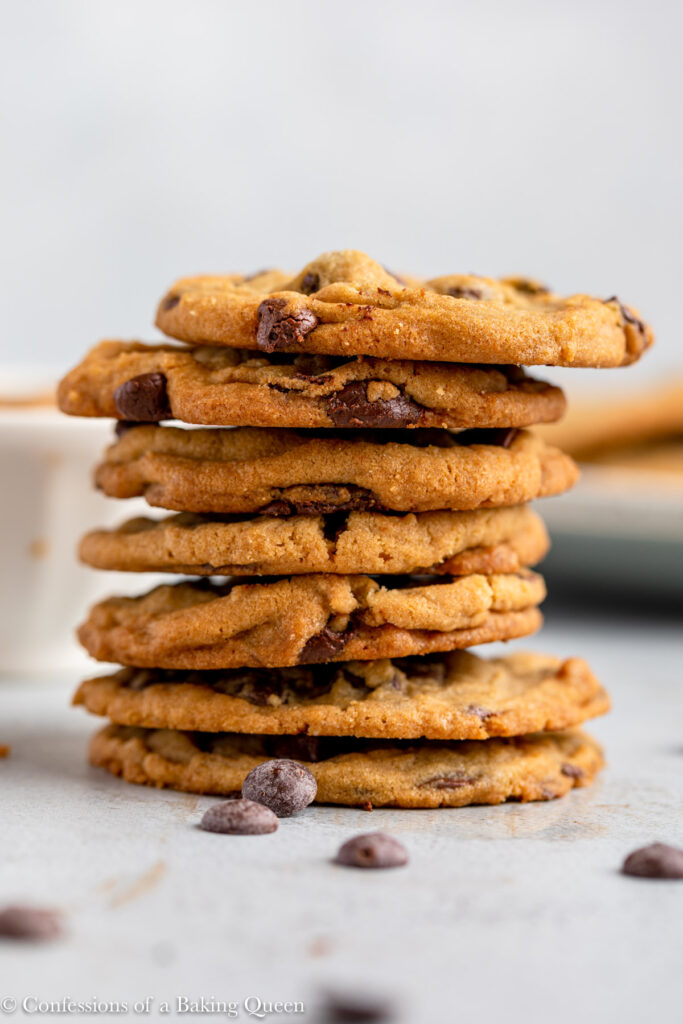 stack of biscoff chocolate chip cookies on a grey surface